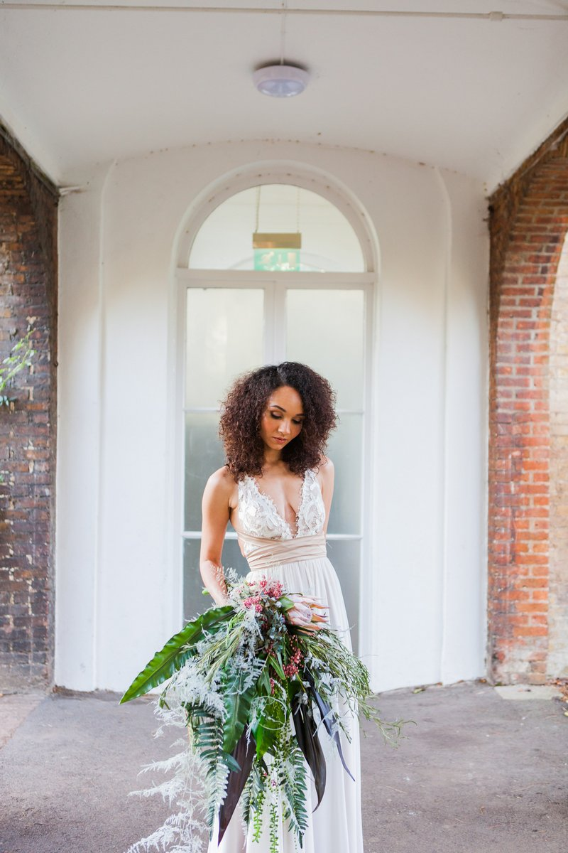 Bride holding oversized tropical bouquet
