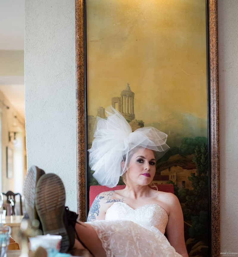 Bride sitting with feet up on table