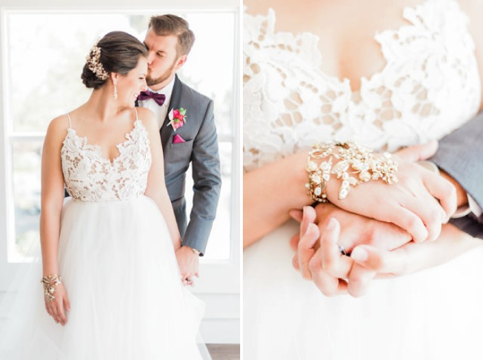 Groom standing behind bride with wrist accessory