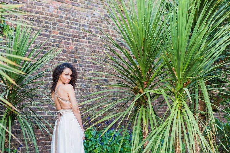 Bride next to long grass plants