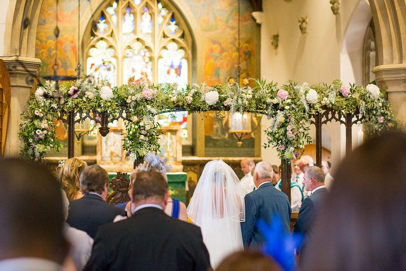 Flowers over altar for wedding ceremony