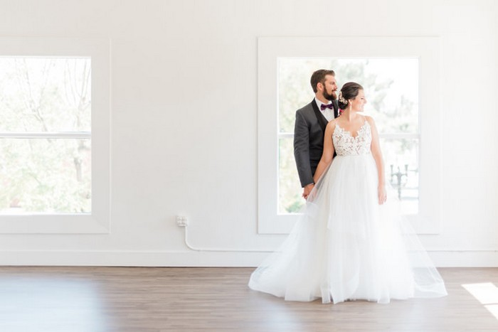 Bride and groom in empty room