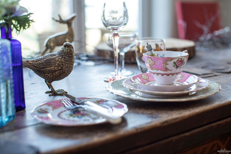 Pink china cups and saucers on rustic wedding table