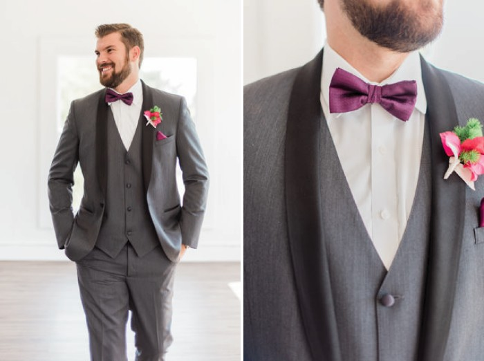 Groom wearing grey suit and purple bow tie