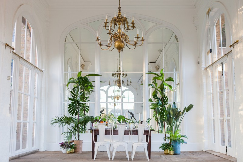 Wedding table with palm leaf and gold styling in Holland Park Orangery