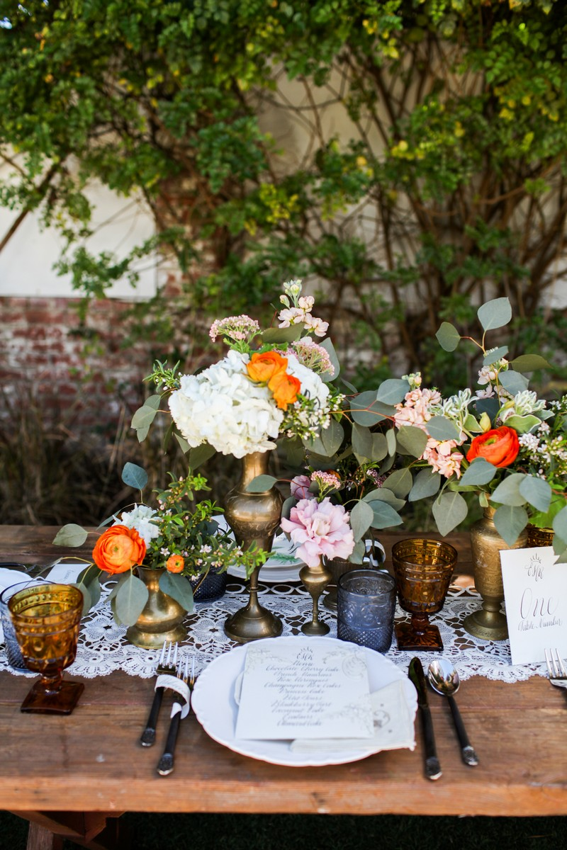Rustic wedding place setting with orange and white flowers