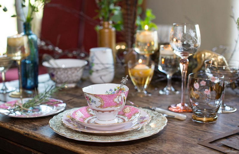 Pink china cup and saucer on rustic wedding table
