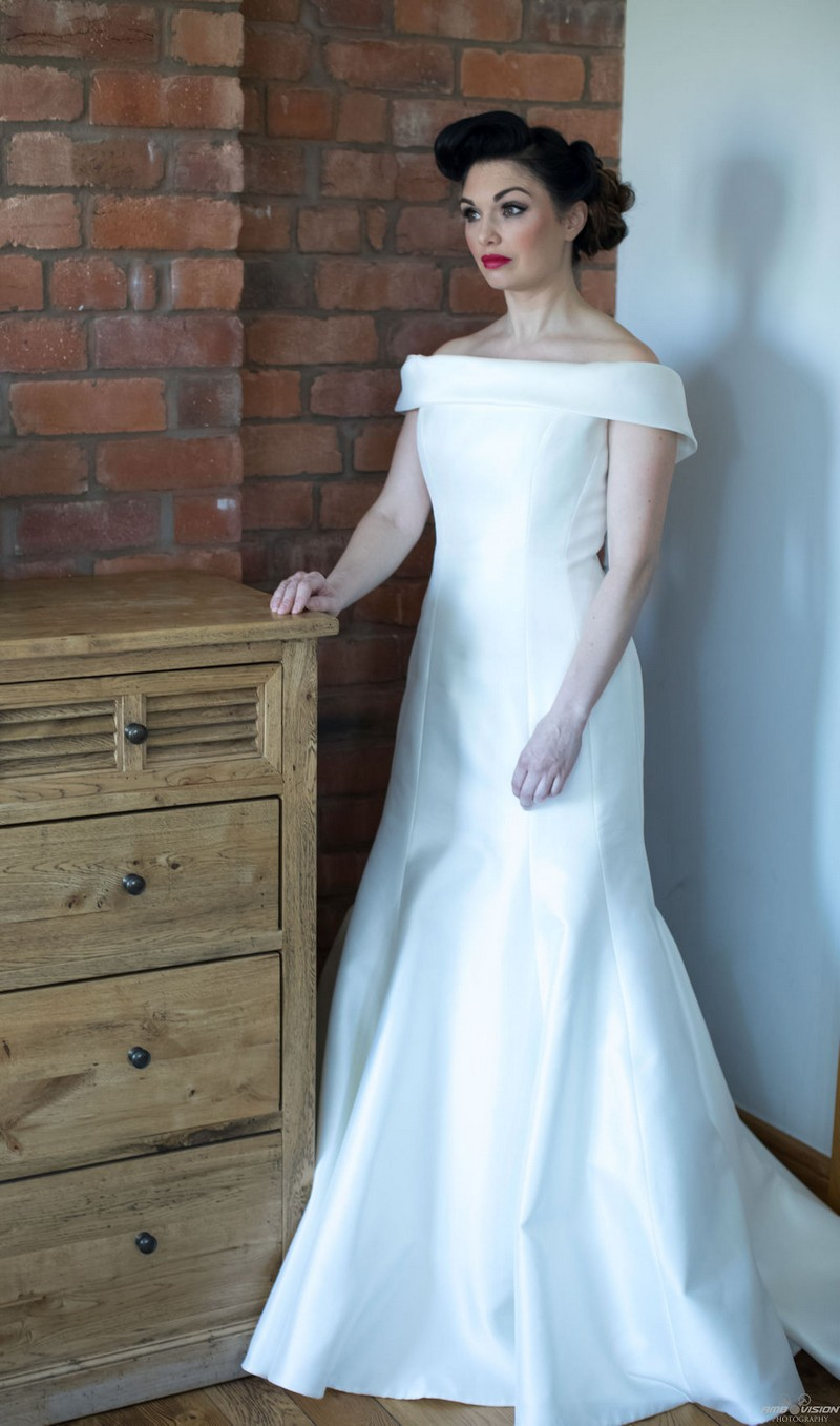 Bride standing next to chest of drawers