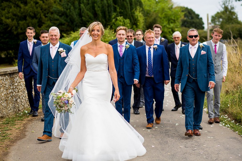 Bride with groomsmen in blue suits
