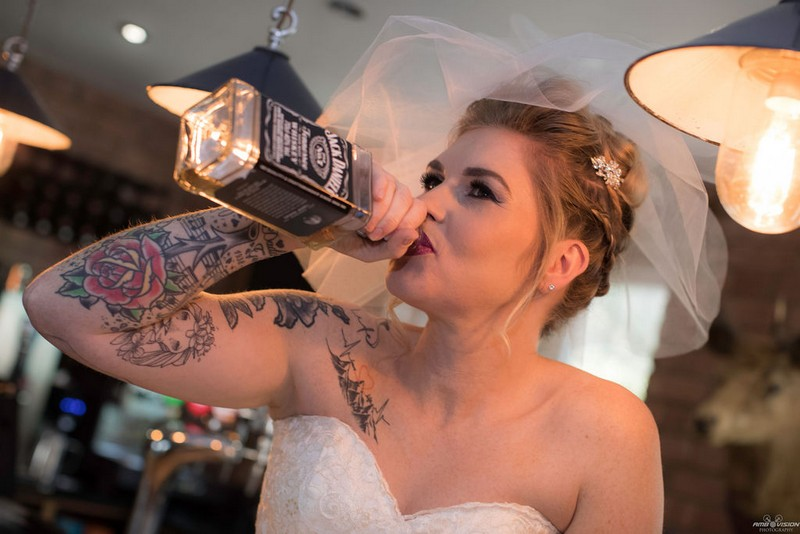 Bride drinking from Jack Daniel's bottle