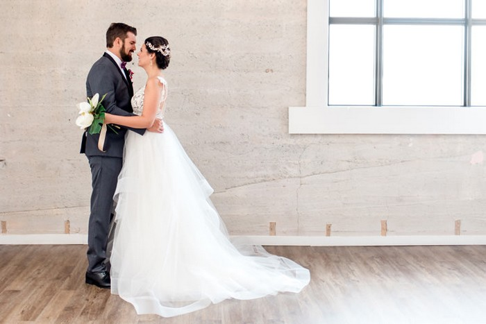 Bride and groom in warehouse venue
