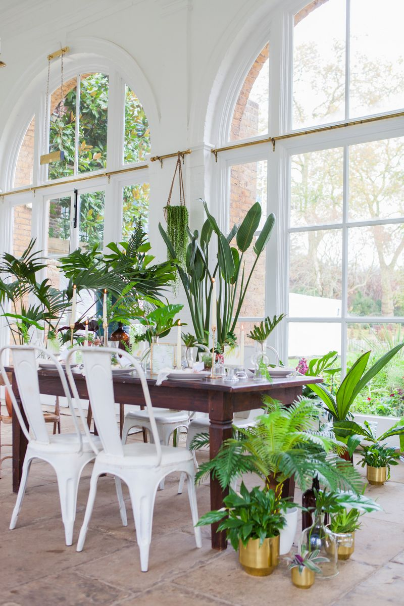 Wedding table with tropical palm styling