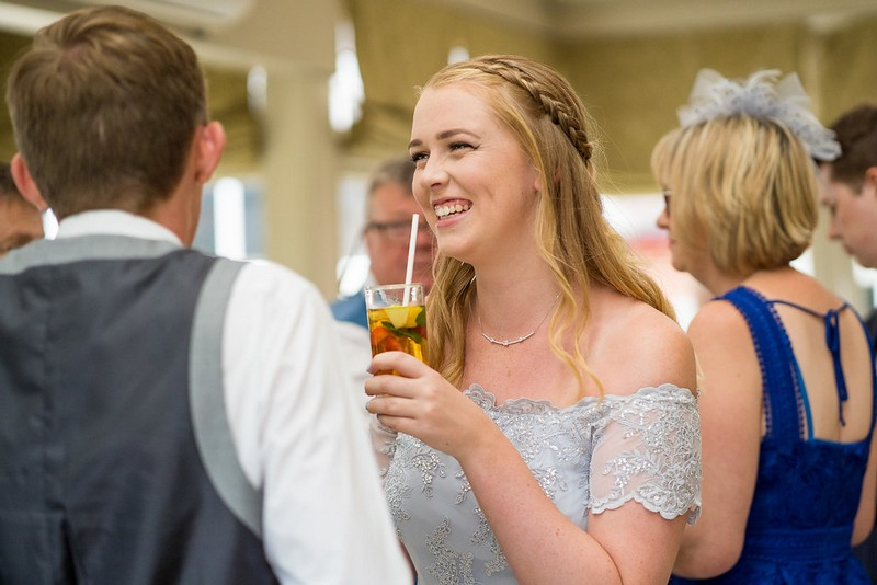 Bridesmaid with glass of Pimm's
