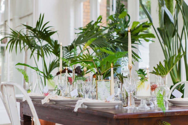 Wedding table styled with tropical palm leaves