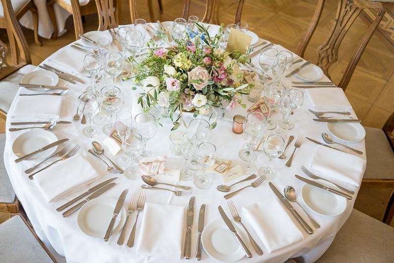 Round wedding table with garden flower centrepiece