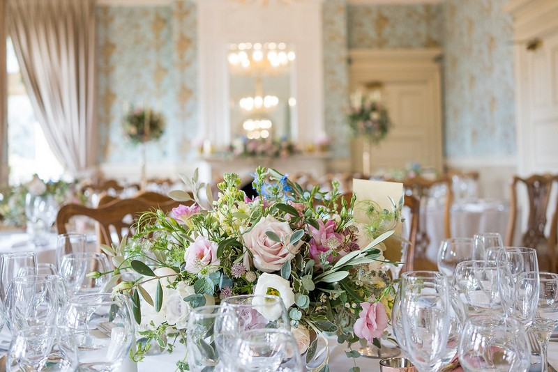 Garden flowers in centre of wedding table at Pendley Manor