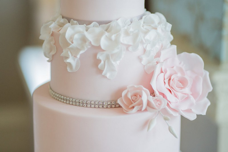 Sugar flowers and ruffles on pink wedding cake