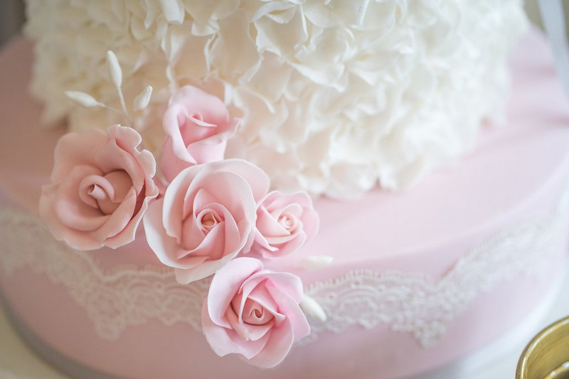 Pink sugar flowers on wedding cake