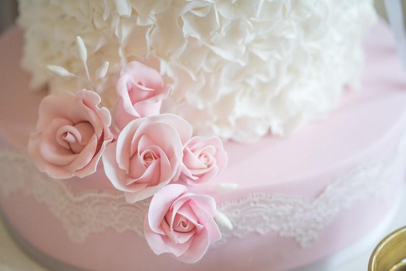 Pink sugar flowers on wedding cake