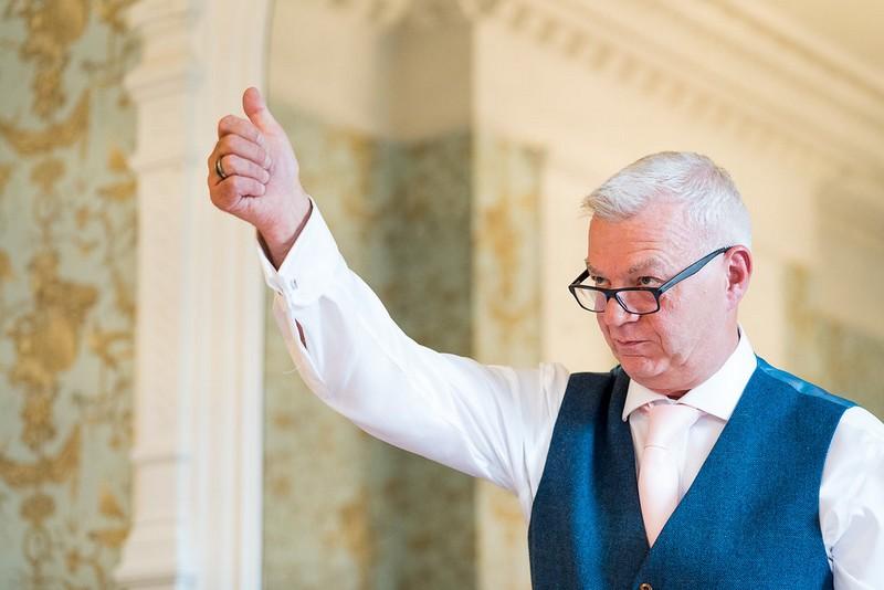 Man giving thumbs up during speech