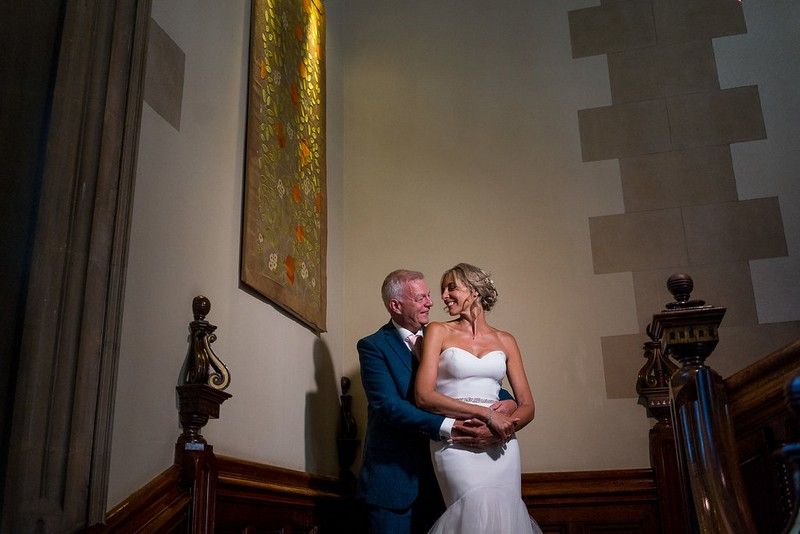 Bride and groom on stairs at Pendley Manor