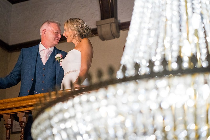 Bride and groom on gallery at Pendley Manor