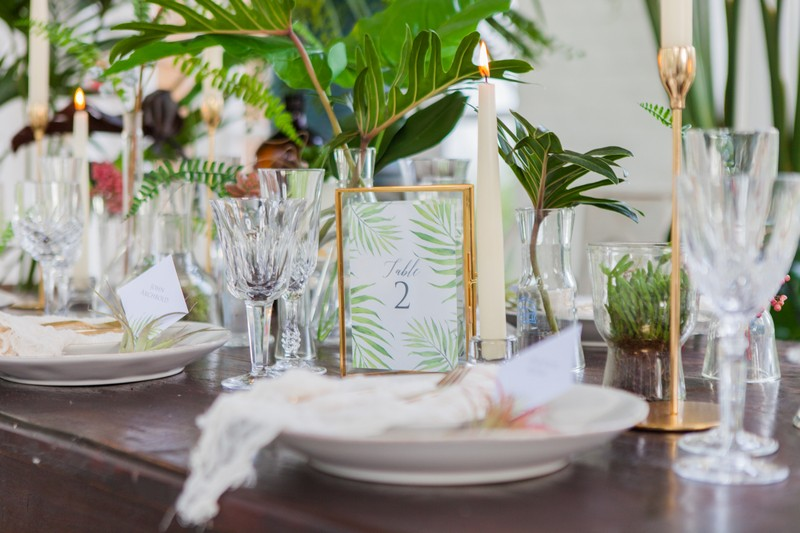 Palm and gold wedding table styling