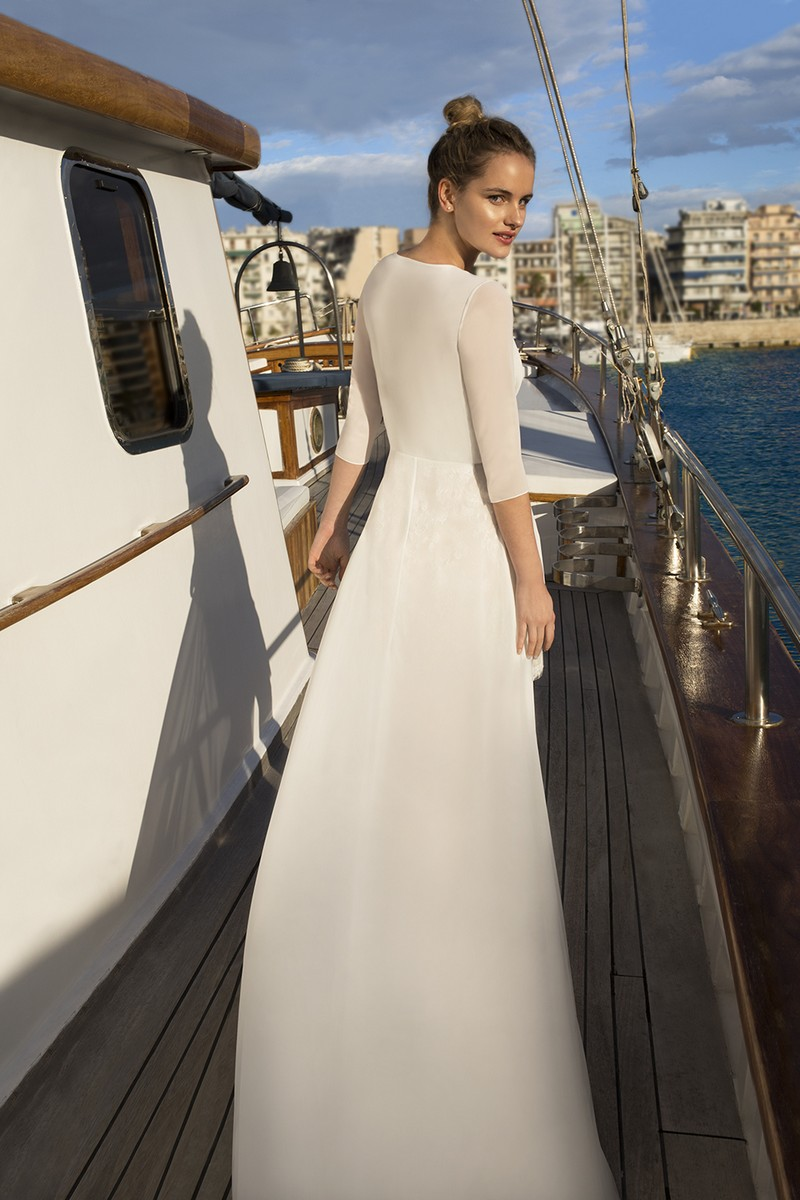 Back of DR256 Wedding Dress with Cape from the Demetrios Destination Romance 2019 Bridal Collection