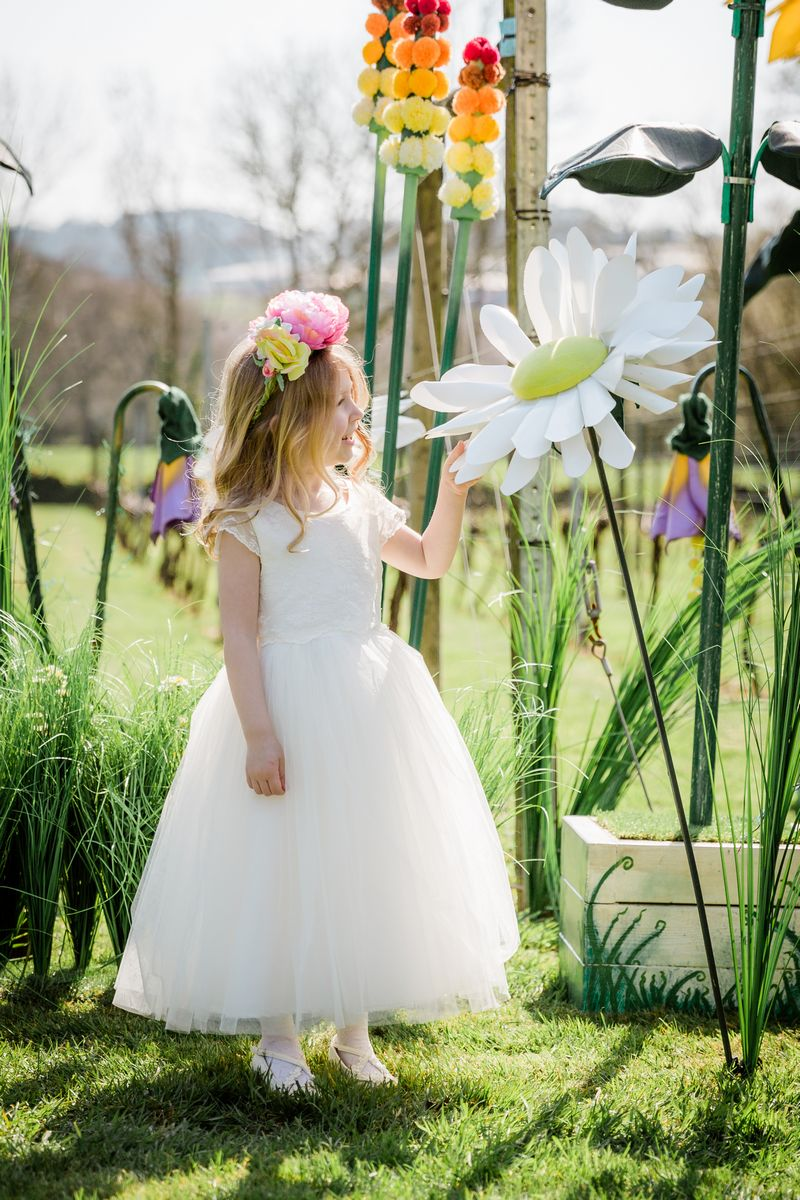 Flower girl touching Giant Flower