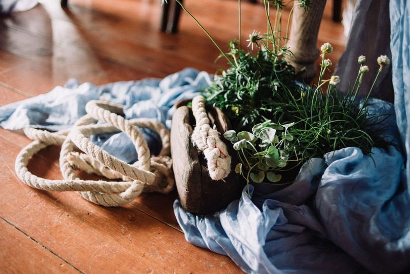 Rope and plant on top of blue linen on floor