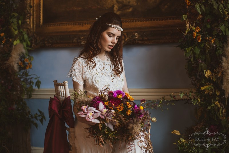 Bride sitting in chair holding bouquet