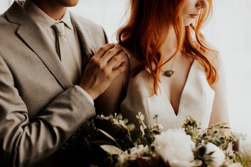 Groom's hand on bride's shoulder