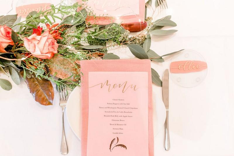 Coral menu at bridal shower place setting