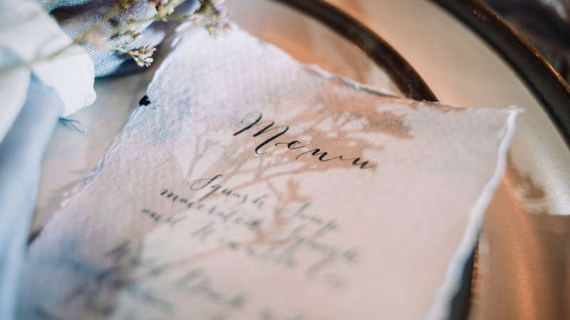 Wedding menu written on rustic paper