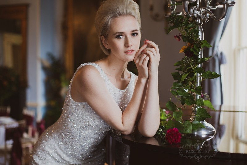 Bride leaning on piano
