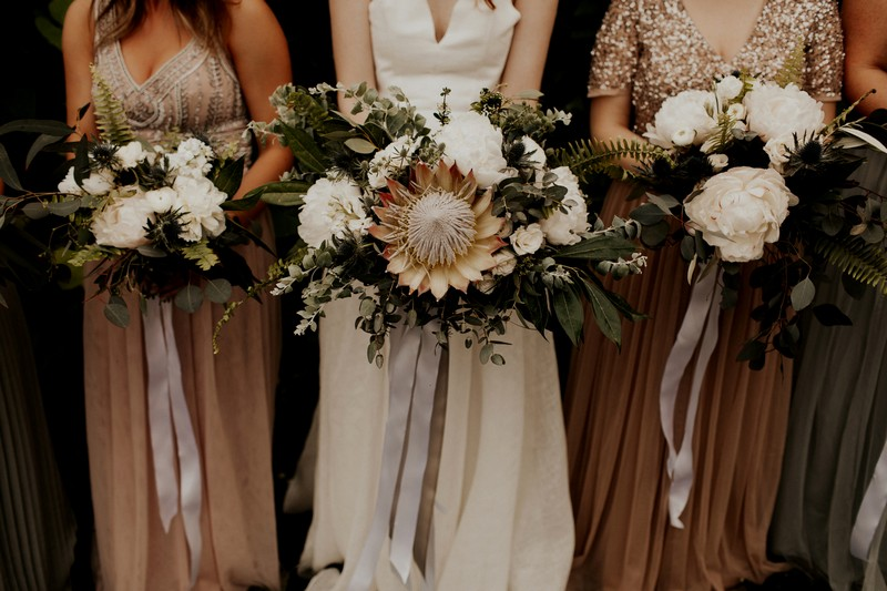 Bride and bridesmaid bouquets with large flowers