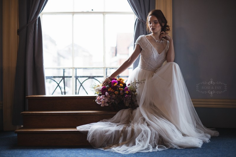 Bride sitting by window of Assembly Room in Devizes Town Hall