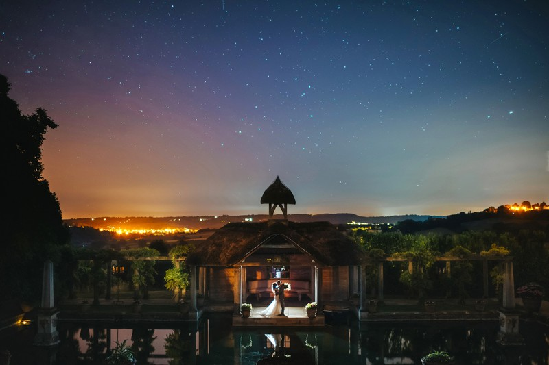 Bride and groom by pool at Euridge Manor under starry sky - Picture by Joab Smith