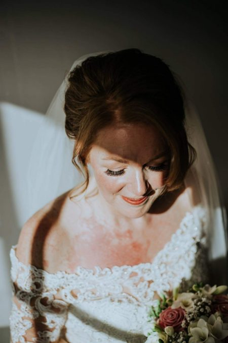 Bride holding bouquet - Picture by Rebecca Rose Noller Photography