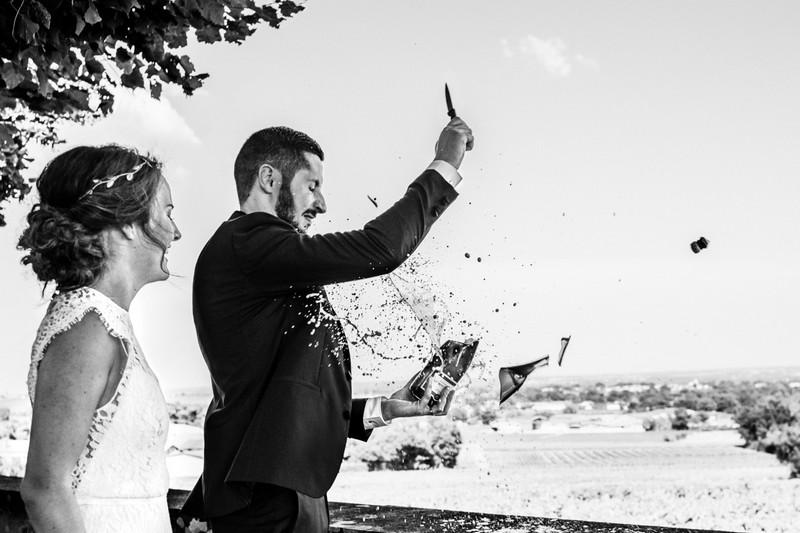 Bottle breaking as groom opens Champagne with a knife - Picture by Alison Bounce Photography