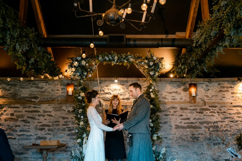 Wedding ceremony in The Wainhouse at Dewsall Court