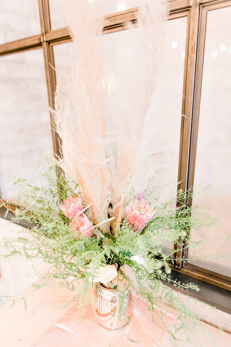 Floral arrangement with pampas grass