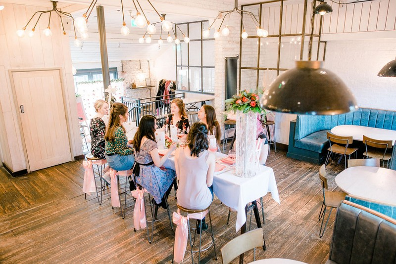 Girls sitting at bridal shower table