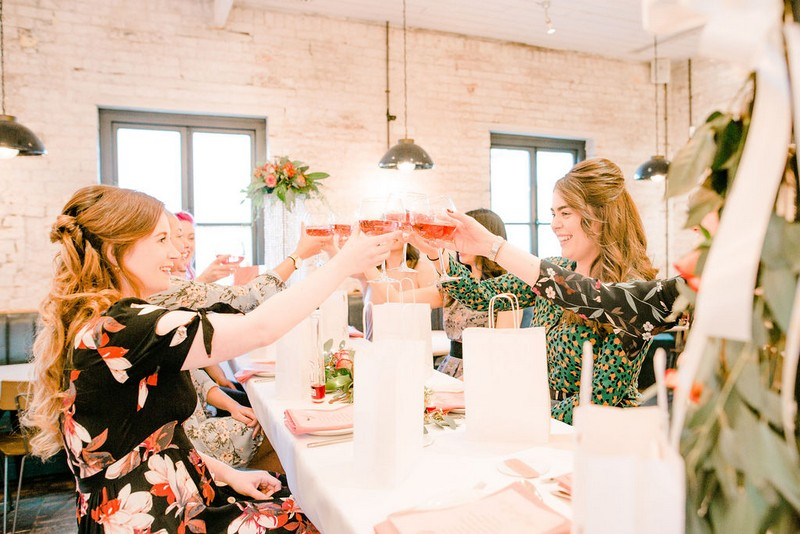 Girls toasting with glasses at bridal shower