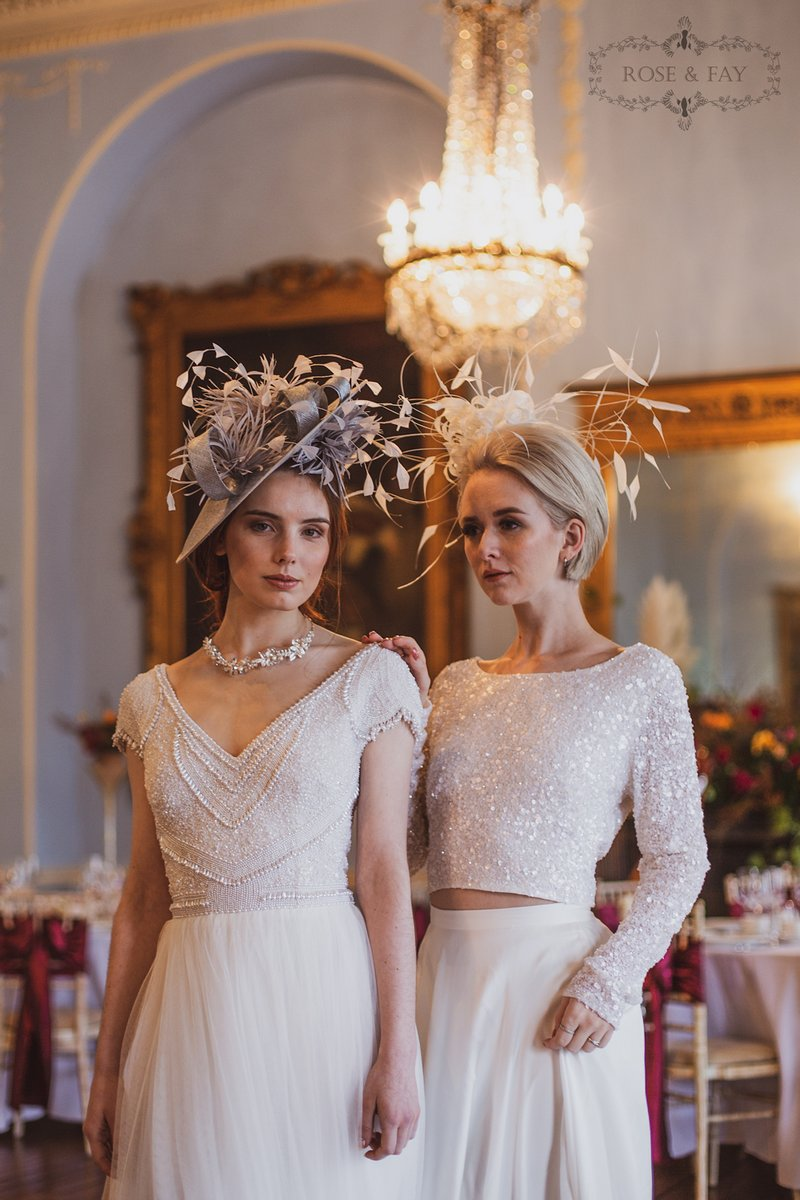 Two brides wearing hats