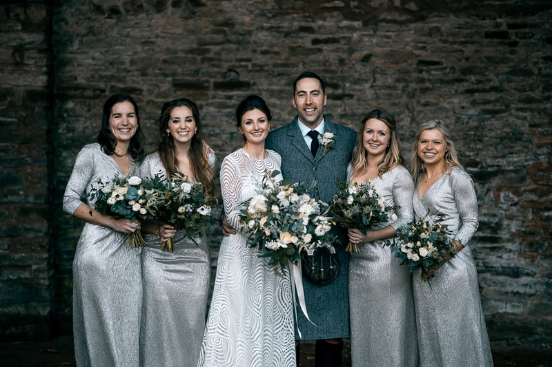 Bride and groom with bridesmaids