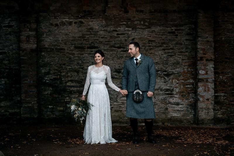 Bride with groom in Scottish wedding attire