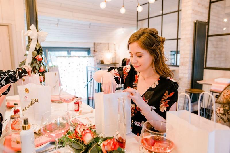 Bride-to-be taking gifts from bag at bridal shower