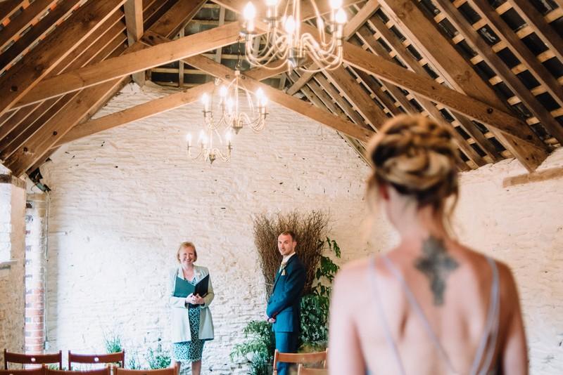 Bride walking down aisle for elopement at New Barton Barns