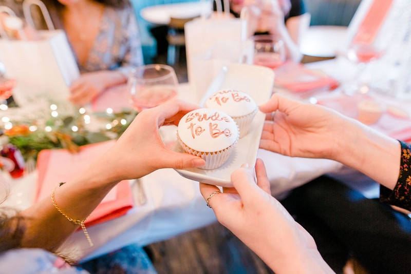 Handing round bridal shower cupcakes